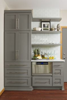 I like the shelves for above table in kitchen. Gray kitchen | Fiddlehead Design Group