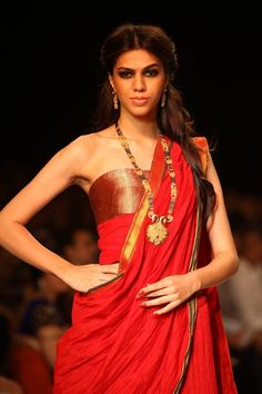 A model showcases the Mangalsutra collection on day 3 of the India International Jewellery Week 2013. #Bollywood #Fashion