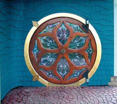 The handcrafted hobbit door looks right at home set into this beautifully shingled wall. Barbara and Don McKee's Hobbit-house style door was inspired by their love of Art Nouveau and mythical details. The double-layered mahogany door built by Don surrounds stained-glass panels crafted by Barbara. (Fine Homebuilding)