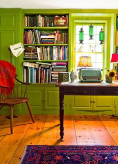 I love the bright green chartreuse color and the built in bookcases and cupboards.  Also, the wide planks of wood on the floor!
