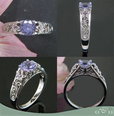 Custom platinum ring with a vibrant lavender sapphire center, hand fabricated lilies and filigree, and purple diamonds along the sides.