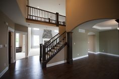 One of my favorite entryways... feels grand without losing the charm.  This is the Eleanor 3500   #entryway #twostory #trim #catwalk #arches #home #newhome