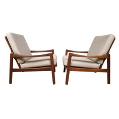 danish chairs | Pair of Danish modern teak lounge chairs at 1stdibs