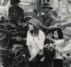 Jane Fonda with what looks like a Nikon F in 1972 during the Vietnam War.This picture caused controversy at the time due to Fonda being photographed seated on an anti-aircraft battery in North Vietnam. Jane Fonda, Jane Seymour, World History, World War, Louisiana, Che Guevara, Historia Universal, Vietnam War Photos, My War