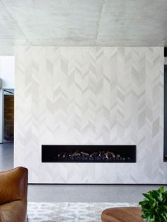 Some nice subtle tiling around the fireplace of this house by mckimm