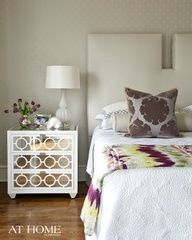 wood floors, layers of white + colorful textiles