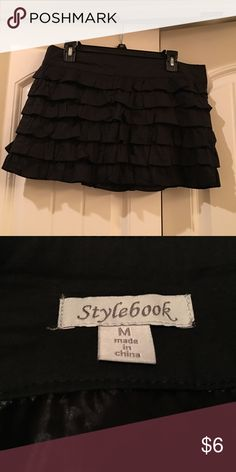Mini black ruffled skirt Mini layered black ruffled skirt, very pretty and would go well with heels, strappy sandals, or any boots. Smoke & pet free home. stylebook Skirts Mini