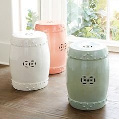 Maybe one of these in coral or celadon and you can put a plant on top