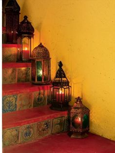 Moroccan style Laterns. LOVE the tiles on the stairs