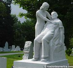"This shows the dying Louis Brusa being comforted by his wife. He died in 1937 at an early age from silicosis, or ""stonecutter's disease."" He carved his own tombstone in his dying days."