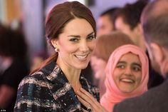 Kate chats to guests at the National Football Museum where she spoke about doing a lot of running around after her children Prince George and Princess Charlotte
