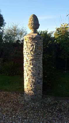 Drystone pillar with vintage composite pineapple, by Nigel Chivers.