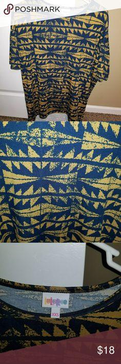 Lularoe Irma Navy Blue and goldish/burnt orange color. New with tags. Soft cotton material. Size xxs LuLaRoe Tops Tunics