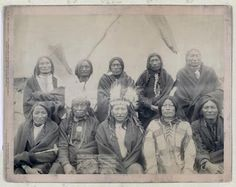 Title: Indian chiefs who counciled with Gen. Miles and setteled [sic] the Indian War -- 1. Standing Bull, 2. Bear Who Looks Back Running [Stands and Looks Back], 3. Has the Big White Horse, 4. White Tail, 5. Liver [Living] Bear, 6. Little Thunder, 7. Bull Dog, 8. High Hawk, 9. Lame, 10. Eagle Pipe Group portrait of Lakota chiefs, five standing and five sitting with tipi in background--probably on or near Pine Ridge Indian Reservation. 1891. Repository: Library of Congress Prints and…