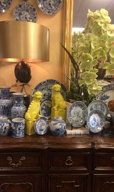 Blue and White Pieces enhance a traditional Sideboard paired with Large Scale Contemporary Lamps and Pops of Color! All here at Peddler!