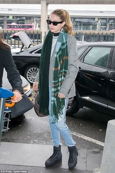Au revoir: The trend-setting starlet made her way through the airport on a damp day in France