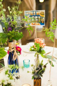 """postcards as table """"numbers"""" on wedding tablescape"""