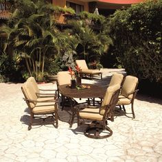 Coco Isle 7 Piece Tropical Outdoor Dining Oval Table and Cushioned Chair Set by Castelle by Pride Family Brands - Baer's Furniture - Outdoor Dining Set Miami, Ft. Lauderdale, Orlando, Sarasota, Naples, Ft. Myers, Florida