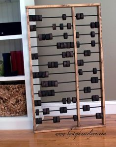 homemade abacus- would be fun with different colors and shapes of beads on each level!