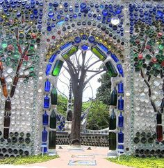 Wall arch made with wine bottles.