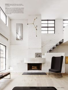 white brick + modern fixtures + cool stairs