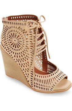 rayos perforated wedge sandal by Jeffrey Campbell. A celebration of angles and textures radiates brilliantly from twin perforated medallions adorning the shaft of a boo. Lace Up Wedge Sandals, Lace Up Wedges, Wedge Shoes, Shoes Sandals, Summer Wedge Sandals, Nude Sandals, Nude Heels, Top Shoes, Jeffrey Campbell Sandals