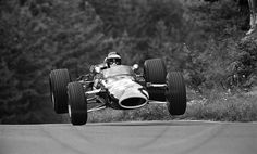 Jackie Oliver airborne in the Lotus-Ford, 1967 F1 German Grand Prix, Flugplatz section on the Nürburgring Nordschleife