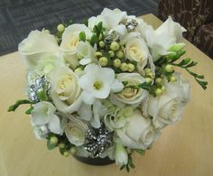 Wedding bouquets; Pittsburgh Weddings; Wedding Flowers; Blumengarten; Bride's bouquet of white hydrangea, ivory roses, white freesia and ivory hypericum berries, with added brooches and pearls; www.blumen.com