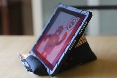 Make your own ipad or ereader stand.  http://www.bettycrockerass.com/2011/10/updated-ipad-rest-tutorial.html