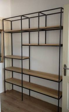 Like the clean lines, metal/wood combo and different lengths/heights of the shelves. Shelf Furniture, Metal Furniture, Furniture Design, Industrial Living, Industrial Shelving, Muebles Living, Wood Steel, Storage Shelves, Home And Living