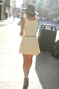 I love the white dress and how the hat and belt tie everything together.
