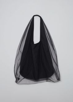 Delicate, stylish and versatile, the Parachute Tote is a tulle double-layered shoulder bag, that hangs loosely and highlights any casual activity. Leather Handbags, Leather Bag, Fashion Bags, Fashion Accessories, Top Casual, Designer Totes, Fabric Bags, Look Cool, Creations