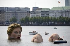 Giant woman sculpture in European lake