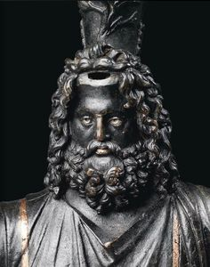 A Roman bust of Zeus-Serapis, with silver and copper inlays, 2nd century A.D.