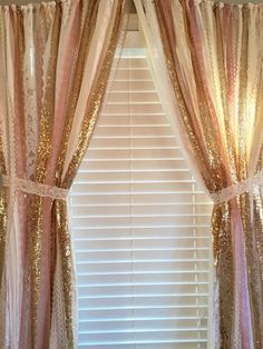 Pink and gold garland curtain is made with a blends of ivory, white, pink and sparkley gold sequin and lace. Torn and rag tied - edges are meant to