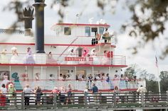 A boatload of belles arrive by river on the Henrietta III (photo courtesy of the North Carolina Azalea Festival)