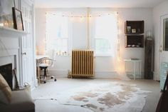 This one is easy! Hang lights around your windows for an eye-catching effect.  Photo by Hello Love Photography via Style Me Pretty