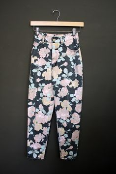 I had this same pair of floral jeans.  I wore them with a mint green colored shaker sweater, socks and chunky earrings.  It was one of my favorite outfits ever.