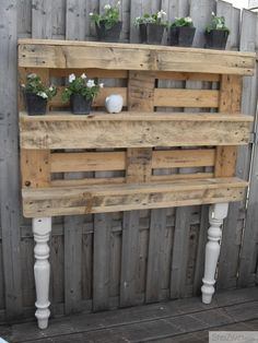 Cute garden shelves from recycled pallets and table legs.