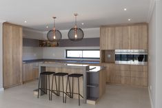 Clean and simple design open plan layout with functional spaces,natural wood textures add warmth. Designer home in Langebaan Country Estate. Country Estate, Wood Texture, Open Plan, Simple Designs, Natural Wood, Architecture Design, Layout, Kitchen, Furniture