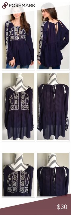 ‼️Last One‼️Boho Navy/Ivory Top 🎉HP🎉 Super adorable Boho style navy and ivory top. Ivory flower detail on  bust and down sleeves. Gathering around neckline and ties in the back. Slits in back. Lightweight. 100% Rayon Hand wash Measurements: Small: Bust-18 in; Length-28 in; Sleeves-25 in long. Medium: Bust-19 in; Length-28 in; Sleeves-26 in long. Large: Bust: 20 in; Length-28 in; Sleeves-26 in long. ‼️ Medium and Small available in my closet in seperate listing‼️ 🎉Host Pick Best In Tops…
