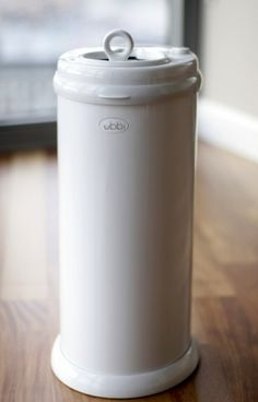Ubbi Money Saving, No Special Bag Required, Steel Odor Locking Diaper Pail, White Price: (as of - Details) The Ubbi Steel Diaper Pail is made of powder-coated steel to achieve max. Kitchen Garbage Bags, Kid Essentials, Diaper Pail, Nursery Accessories, Thing 1, Trash Bag, Childproofing, Baby Gear, Kids And Parenting