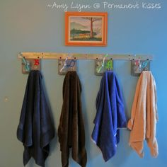 Genius idea. Keeping toothbrushes close together in a drawer is pretty gross. But this way each person has a place to heep their toothbrush and hang their towel.