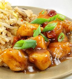 Recipe for Orange Chicken with Fried Rice - Spicy and sweet orange chicken is served with vegetable fried rice.