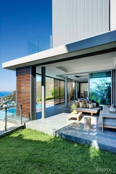 Architecture, Splendid Head Road 1816 Home Project In Cape Town By SAOTA Architects Featuring Exterior Design With Living Room Furniture And Green Grass Lawn: Simple Contemporary Wooden Detail Applied for Modern House