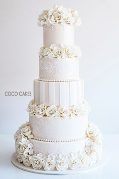 Stunning ivory #wedding cake For more wedding and fashion inspiration visit www.finditforweddings.com Coco Cakes