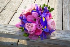 Pink and purple wedding bouquet by Reynolds Treasures. pink garden roses, calla lilies, purple iris, etc...