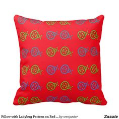 Pillow with Ladybug Pattern on Red Background