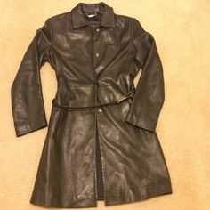 Nicole Miller leather coat Super soft lamb skin. Black leather. Clasp belt that can be removed. Four snap buttons in the front. Collar. Gorgeous. Nice length. Hits above the knee. Nicole Miller Jackets & Coats