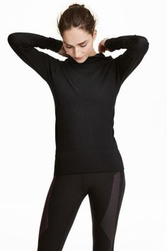 Check this out! Fitted sports top in fast-drying, functional fabric with a drawstring hood and long raglan sleeves. Seamless. - Visit hm.com to see more.